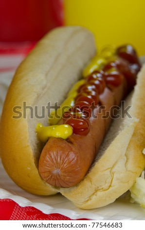 Hot dog with mustard & catsup - shallow depth of field - stock photo