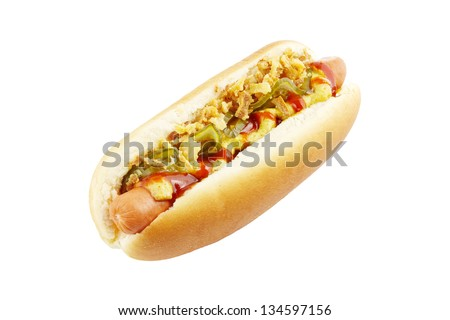 Hot dog with mustard, ketchup, gherkins, and fried onions isolated on white