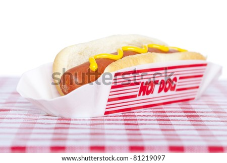 Hot dog with yellow mustard on a check tablecloth