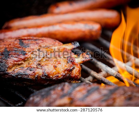 hot dogs andpork ribs  ribs on a gas  grill