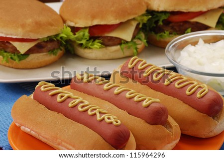 Hot dogs,hamburgers and ingredients. Fast food composition. - stock photo