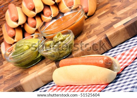 hot dogs on a nice table setting rich in colors and flavors perfect for outdoor parties - stock photo