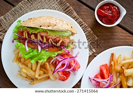 Hot Dogs with French fries on white plate, close-up.Top view. - stock photo