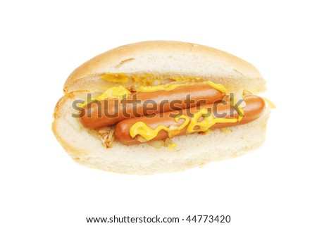 Hot dogs with mustard in a roll isolated on white