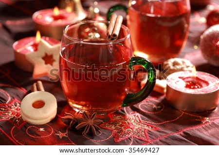 Hot drink for Christmas with delicious cookies - stock photo