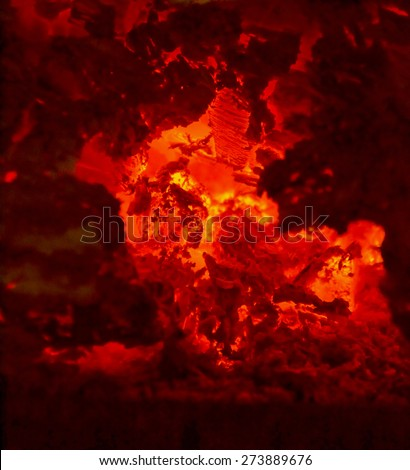 Hot embers in a fireplace. infernal and hellish background - stock photo