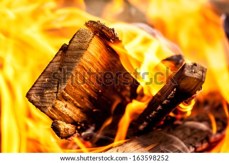hot embers, log wood fire - stock photo