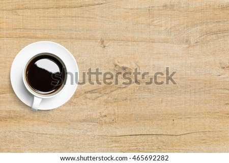 Hot espresso coffee is on top of wood table. Top view with copy space, flat lay.