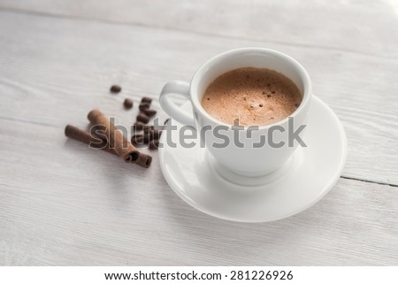 Hot espresso cup on white table - stock photo