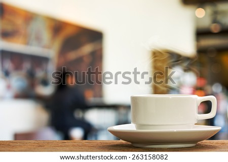 Hot espresso on the table with people do meeting business plan in coffee shop background - stock photo