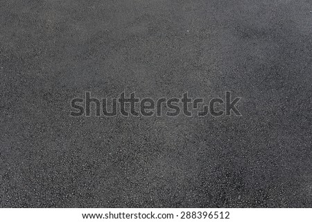 Hot fresh asphalt. - stock photo