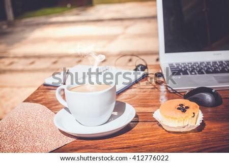 hot fresh coffee on work desk - stock photo