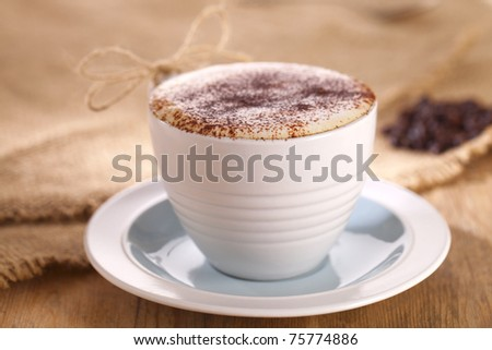 hot frothy drink cappuccino coffee, rustic style, shallow dof - stock photo