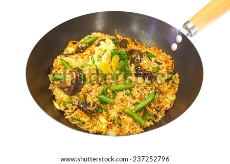 hot frying pan with rice, mushrooms and green beans - stock photo