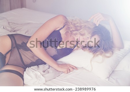 hot gorgeous caucasian woman in black seductive underwear - stock photo