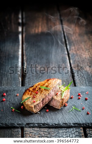 Hot grilled meat with fresh rosemary - stock photo