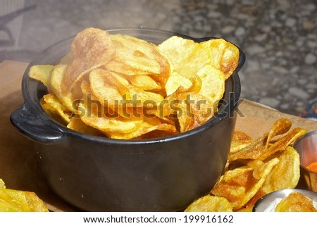 hot homemade potato chips close up - stock photo