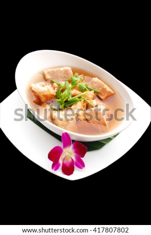 Hot Isolated Fish Soup with Fresh Taro, Chinese Cuisine. Selective focus and Back Background