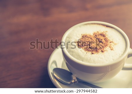 Hot latte art coffee on table ( Filtered image processed vintage effect. ) - stock photo