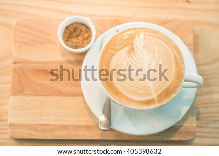 hot latte in coffee shop - stock photo