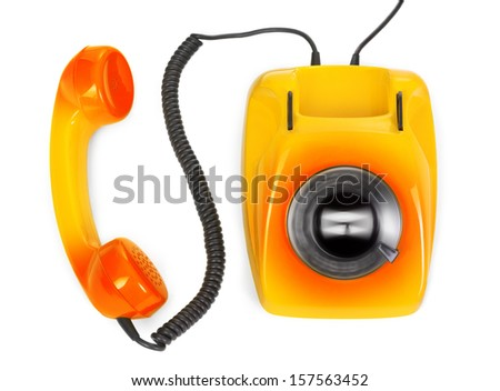 hot line concept - rotary phone with spinning dial on white - stock photo