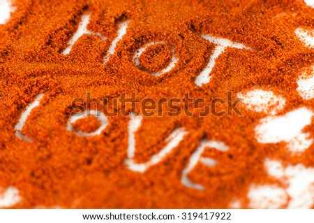 Hot Love writing on paprika background isolated on white. - stock photo