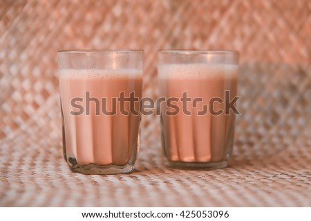 Hot masala tea / masala chai / Teh Tarik, Kerala India. Evening tea with refreshing Indian blend of black tea with milk and spices - stock photo