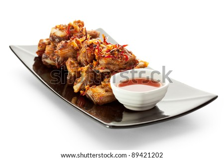 Hot Meat Dishes - BBQ Ribs with Spicy Sauce - stock photo