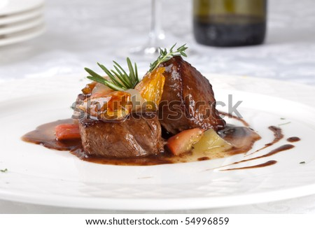 Hot Meat Dishes-Fillet of beef with onions and apple jelly - stock photo