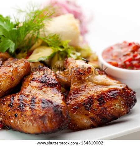 Hot Meat Dishes - Grilled Chicken Wings with Red Spicy Sauce - stock photo