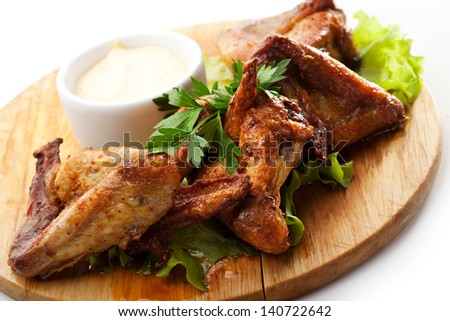 Hot Meat Dishes - Grilled Chicken Wings with White Sauce - stock photo