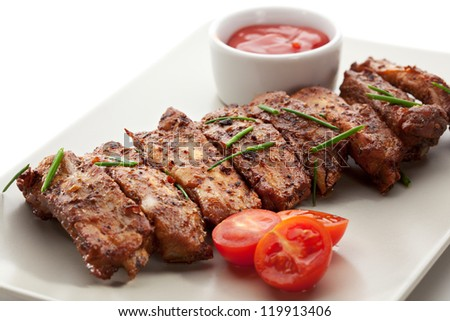 Hot Meat Dishes - Pork Ribs with Tomatoes - stock photo