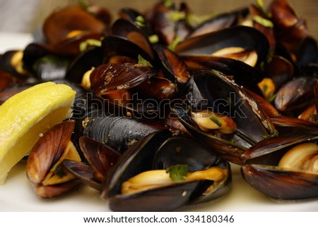 Hot Mediterranean Natural Large Mussels In Shell  Boiled With Wine On The White Plate, Selective Focus  - stock photo