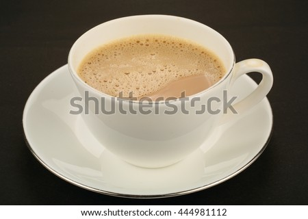 Hot milk tea in white  Porcelain cup . - stock photo