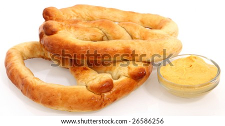 Hot no salt soft pretzels with mustard. - stock photo