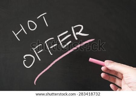 Hot offer words written on the blackboard using chalk - stock photo