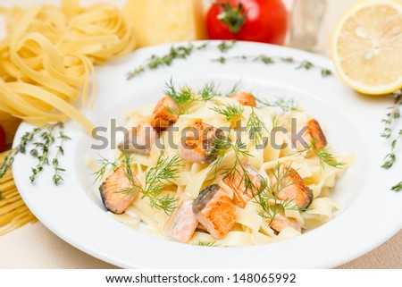 hot pasta with garnish on white plate - stock photo
