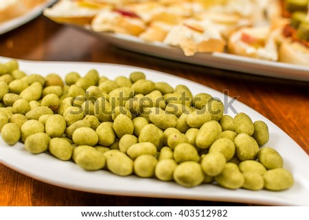 Hot peanut with wasabi on white plate