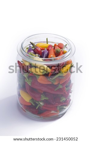hot peppers in glass - stock photo