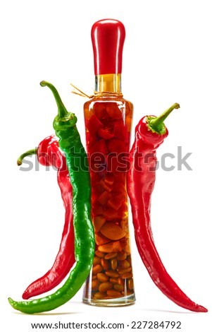Hot red pepper, along with  bottle spices, studio shooting - stock photo