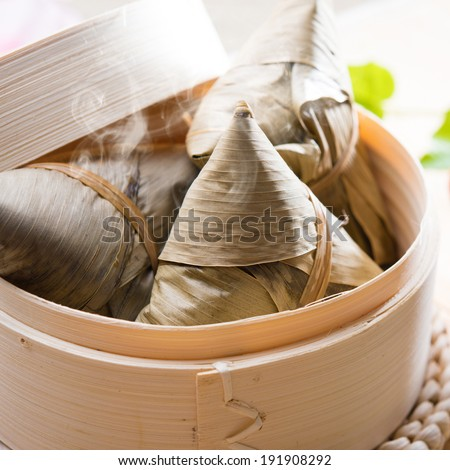 Hot rice dumpling or zongzi. Traditional steamed sticky glutinous rice dumplings. Chinese food dim sum. Asian cuisine. - stock photo