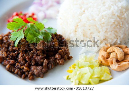 hot rice with Salted Olive, green herbs and nuts : delicious tradition food - stock photo