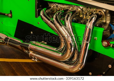 Hot rod exhaust system looking very new and shiny. - stock photo