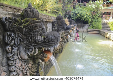 Hot sacred springs in Bali, Indonesia. Swimming pool for ritual bathing. - stock photo