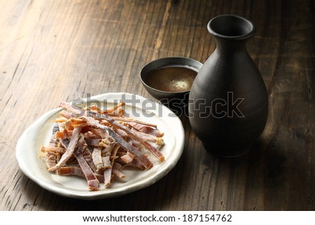 Hot sake and Dried squid - stock photo