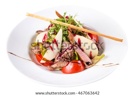 hot salad with meat and pear in dish isolated on white background