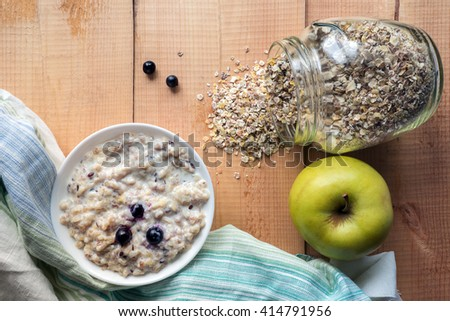 Hot seven grains porridge with fresh berries. Uncooked whole grain, rolled oats. Top view - stock photo