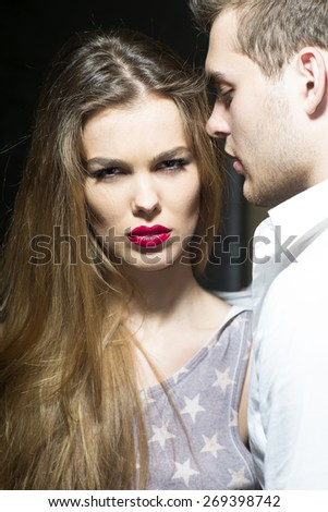 Hot sexy couple staniding close to each other, vertical picture - stock photo