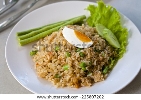 Hot shrimp paste sauce with crispy fried fish and sweet pork,Fried rice with Chili paste Rua. - stock photo
