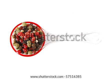 hot small colored pepper over white background